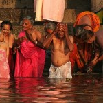Bathers entering the Ganges at dawn