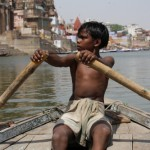 Young boy steers us down the Ganges River