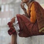 Elderly woman sitting on the ghats of Varanasi