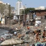 Children swimming along the Mumbai fishing wharf slums