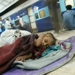 Child sleeping on the floor of the train station