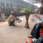 Passengers play the waiting game on train station platform