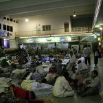 Crowded floors of the Mughal Serai train station at night