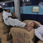 Passengers catch some shut eye while waiting for train