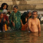 Pilgrims bathing in the sacred waters at sunrise