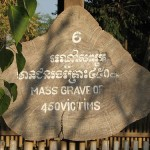 A sign marks the spot of a mass grave of 450 victims